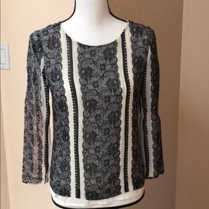 Black and white silk blouse.